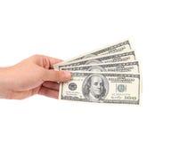 Los hombres dan con 100 dólares de billetes de banco Imagen de archivo