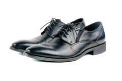 Zapatos atados hombres de cuero negros elegantes Fotos de archivo