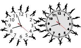 Los hombres de negocios en una prisa se ejecutan y recorren en los relojes de tiempo Fotos de archivo libres de regalías