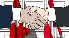 Los hombres de negocios o los políticos sacuden las manos contra banderas de Suiza y de Austria Reunión o cooperación oficial rel almacen de metraje de vídeo