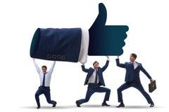 Los hombres de negocios que apoyan los pulgares suben gesto imagen de archivo