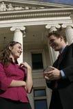 Los hombres de negocios, todos sonríen Imágenes de archivo libres de regalías