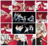 Los hombres y las mujeres que luchan en el entrenamiento del Aikido en escuela de artes marciales Forma de vida y concepto sanos  Fotografía de archivo libre de regalías