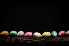 Los huevos de Pascua bajan el tercer espacio de la copia Foto de archivo libre de regalías