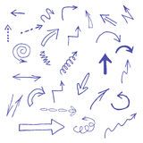 Los iconos azules dibujados mano de las flechas fijaron en blanco Imagen de archivo libre de regalías