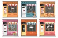 Los iconos de la fachada de las tiendas y de las tiendas fijaron en estilo plano del diseño Imágenes de archivo libres de regalías