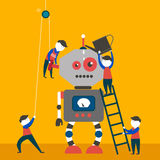 Los ingenieros son de fabricación y de comprobación del robot enorme imagenes de archivo