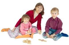 Los juegos de la mujer con los niños Foto de archivo libre de regalías