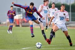 Los juegos de Sandro Ramirez con la juventud de F.C Barcelona combinan contra Gimnastic de Tarragona en Ciutat Esportiva Joan Gamp foto de archivo