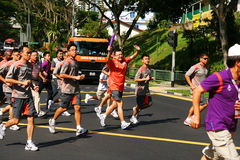 Los Juegos Olímpicos 2010 de la juventud Torch el relais Imagen de archivo libre de regalías
