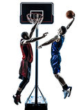 Los jugadores de básquet sirven la silueta dunking de salto Imagen de archivo libre de regalías