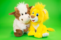 Los juguetes de los niños de un toro y de un león Fotografía de archivo libre de regalías