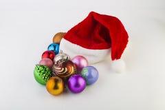 Los juguetes del Año Nuevo en un fondo blanco Imagen de archivo libre de regalías