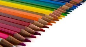 Los lápices multicolores fijaron aislado en un fondo blanco Imagen de archivo libre de regalías
