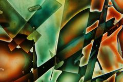 Los líquidos coloridos se mezclaron juntos a una pintura abstracta imagen de archivo