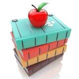 Los libros se elevan con la manzana roja aislada en el fondo blanco Fotografía de archivo