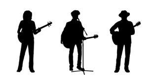 Los músicos que se colocaban que jugaban siluetas de las guitarras fijaron 1 Fotografía de archivo