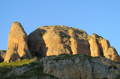 Los Mallos de Riglos unusual shaped red conglomerate rock formation in Spain Royalty Free Stock Photo