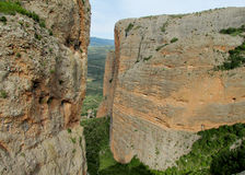 Los Mallos de Riglos unusual shaped red conglomerate rock formation in Spain Stock Photography