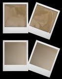 Los marcos polaroid retros de la foto isolaten en negro Fotografía de archivo