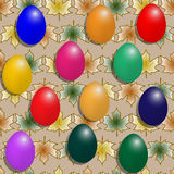 Los mejores huevos de Pascua en un modelo del fondo con las hojas de arce Foto de archivo