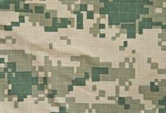 Los militares camuflan el ACU del fondo Imagenes de archivo