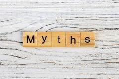 Los mitos redactan hecho con concepto de madera de los bloques foto de archivo libre de regalías