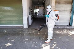 LOS MOCHIS, MEXICO - Apr 29, 2020: health team sanitizing public spaces against the covid-19 coronavirus