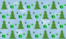 Los modelos ponen verde el árbol de navidad y una caja de regalo Fotos de archivo libres de regalías