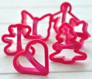 Los moldes para las galletas hicieron el plástico del ââof Imagen de archivo
