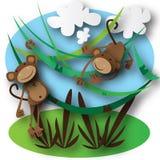 Los monos que saltan en el bosque Fotografía de archivo libre de regalías