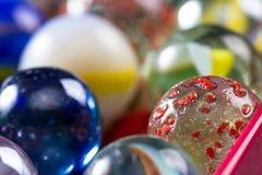 Los mármoles para arriba se cierran para un fondo Imagen de archivo libre de regalías