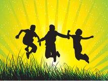 Los muchachos que saltan con alegría Imágenes de archivo libres de regalías