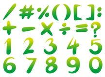 Los números y firman adentro color verde Fotografía de archivo libre de regalías