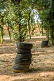 Los neumáticos en la hierba Imágenes de archivo libres de regalías