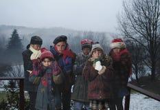 Los niños amontonaron en tiempo extremadamente frío Imágenes de archivo libres de regalías