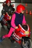 Los niños con las motocicletas que compiten con Imágenes de archivo libres de regalías