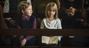 Los niños de la iglesia creen a la familia religiosa de la fe Imágenes de archivo libres de regalías