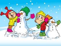 Los niños hacen los muñecos de nieve Imagen de archivo libre de regalías