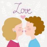 Los niños juntan besarse Foto de archivo