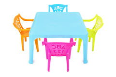 Los niños presentan y las sillas Foto de archivo libre de regalías