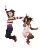 Los niños que saltan inmediatamente Fotografía de archivo libre de regalías