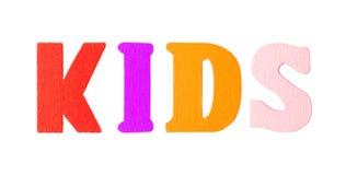 Los niños redactan con las letras de madera Imágenes de archivo libres de regalías