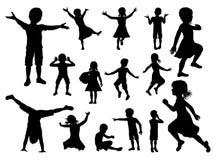 Los niños siluetean el sistema Foto de archivo