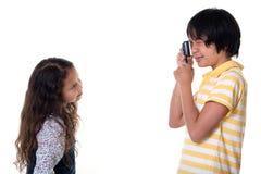 Los niños toman las fotos digitales Fotografía de archivo libre de regalías
