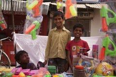 Los niños felices indios colorean colores completos del holi Foto de archivo libre de regalías