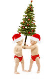 Los niños presentan el árbol de abeto de la Navidad como regalo del Año Nuevo Fotografía de archivo