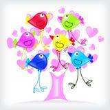 Los pájaros colorean y árbol con los corazones Fotos de archivo