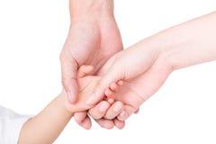 Los padres dan llevar a cabo las manos de los niños aislados en blanco Fotografía de archivo