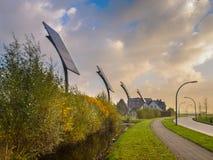 Los paneles solares comunales en una ciudad Imágenes de archivo libres de regalías